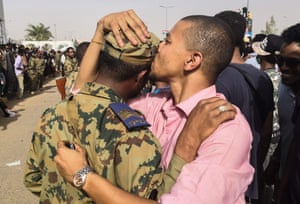 A Sudanese anti-regime protester warmly greets a soldier during protests.