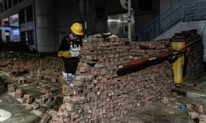 A pro-democracy protester builds a brick wall during a demonstration at the Chinese University of Hong Kong.