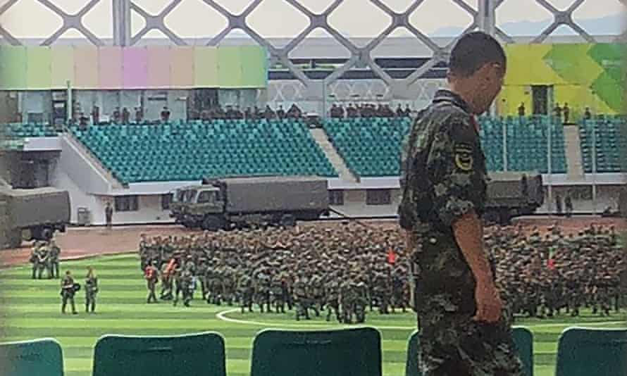 Thousands of Chinese military personnel perform drills at the Shenzhen Bay Sports Centre in August.
