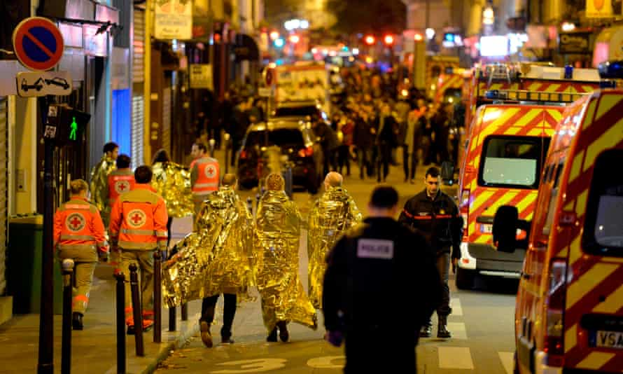 People are evacuated near the Bataclan concert hall during a terrorist attack in Paris in 2015.