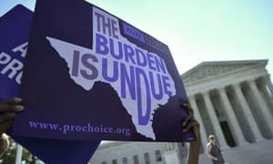 An abortion rights activist holds a sign outside of the US supreme court in Washington DC.