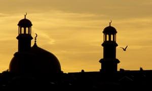 The minarets of the Masjid E Tauheedul in Blackburn, UK. During Ramadan, Muslims fast between sunrise and sunset