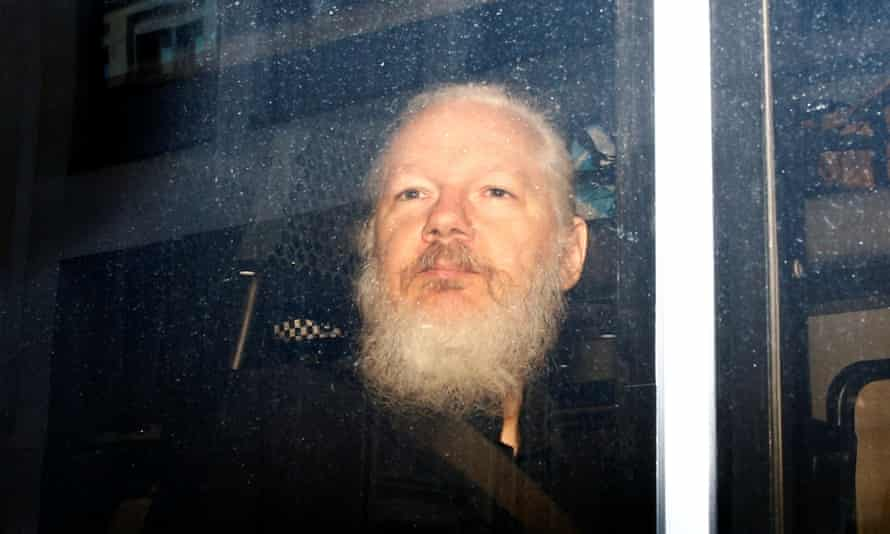 WikiLeaks founder Julian Assange is seen in a police van, after he was arrested by British police in April.
