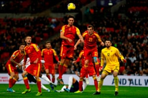 Montenegro's Nikola Vukcevic (center) jumps to clear the ball.