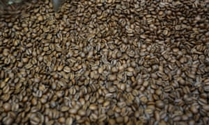 Scott James owner of Coaltown Coffee Roastery in Llandybie near Ammanford, Carmarthenshire, WalesPictured: The coffee beans going through the roaster Wednesday 25 March 2015 Re: Scott James owner of Coaltown Coffee Roastery in Llandybie near Ammanford, Carmarthenshire, Wales.