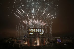Fireworks explode over the Arc de Triomphe during the New Year's Day celebrations on the Champs Elysees, in Paris.