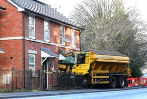 Helsby, UK: A gritting lorry is embedded in a house in Cheshire