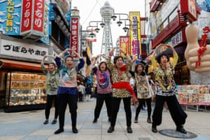 Osaka, Japan. Older people stage a hip-hop and dance performance to welcome leaders to the G20 summit
