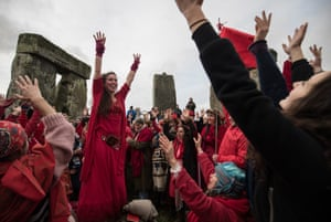 Members of the Shakti Sings choir sing as druids, pagans and revellers gather in the centre of Stonehenge
