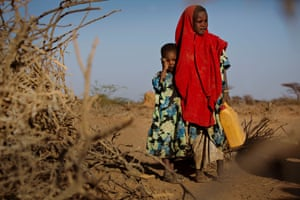 Tirig and her sister Saua in Somalia. Their family was forced to leave their home in search of water and food.