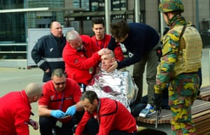 A victim receives first aid by rescuers near Maelbeek metro station