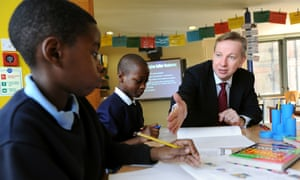 Then education secretary Michael Gove with pupils of Durand Academy primary school in Stockwell, south London, in 2010.