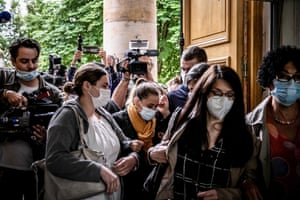 Valerie Bacot arrives at court in Chalon-sur-Saone, France, flanked by relatives and journalists on the last day of her trial on charges of murdering her stepfather turned husband, who she claims abused her since she was 12