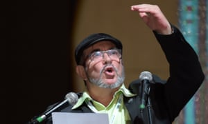 Rodrigo Londoño, known by his nom de guerre 'Timochenko', waves during the opening of the Farc's national congress in Bogotá in August.