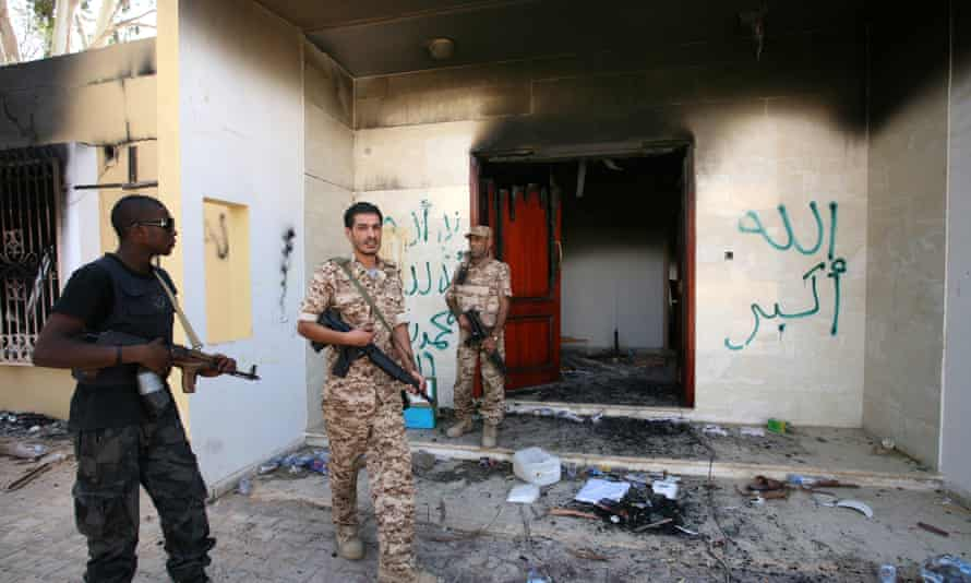 Libyan military guards check one of the US consulate's burnt-out buildings in Benghazi, Libya, in 2012.