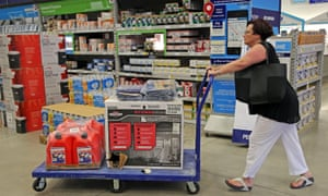 Kerri Vittimberga, of Wilton Manors, buys a generator, tarps and gas cans at Lowe's in Oakland Park, Florida, on Tuesday in preparation for Hurricane Matthew.