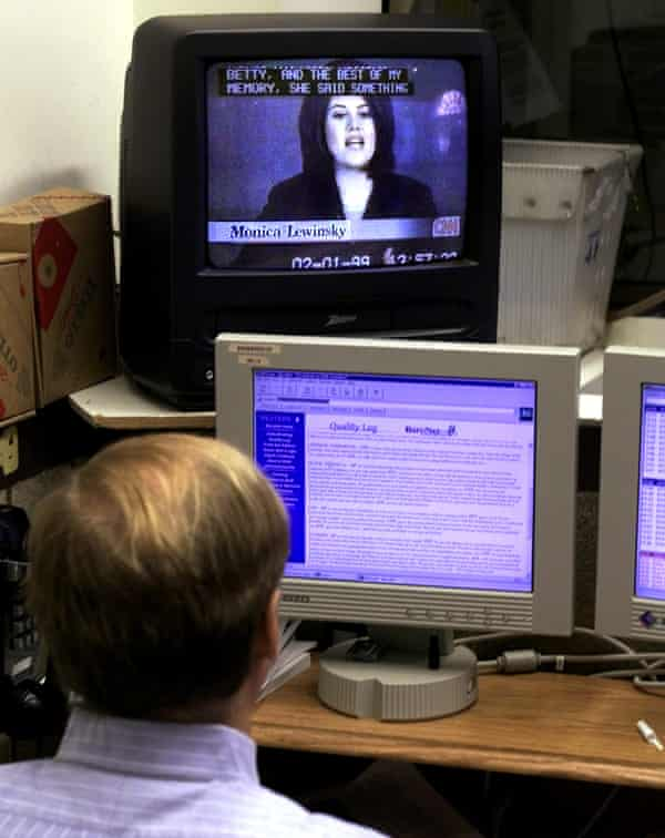 A White House reporter watches Monica Lewinsky's depositon during Clinton's impeachment hearing in February 1999