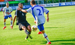 A player from the the Czech Republic's Team CAFH, right, is challenged by an opponent from France's Team UNFP in a tournament where injury can be catastrophic.
