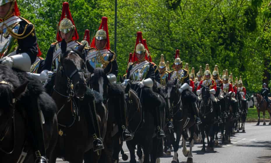 The Household Cavalry return to barracks through Windsor, UK, in June 2021.