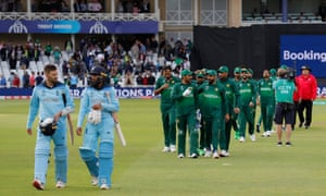 The players leave the pitch after Pakistan's victory.