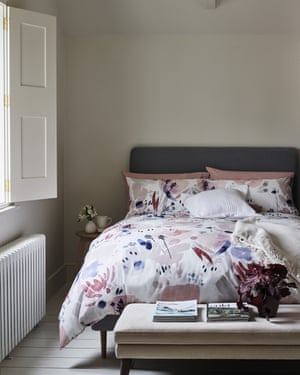 Bedroom in neutral colours with floral bedding