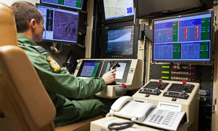 A Reaper drone operator inside a control cabin at RAF Waddington.