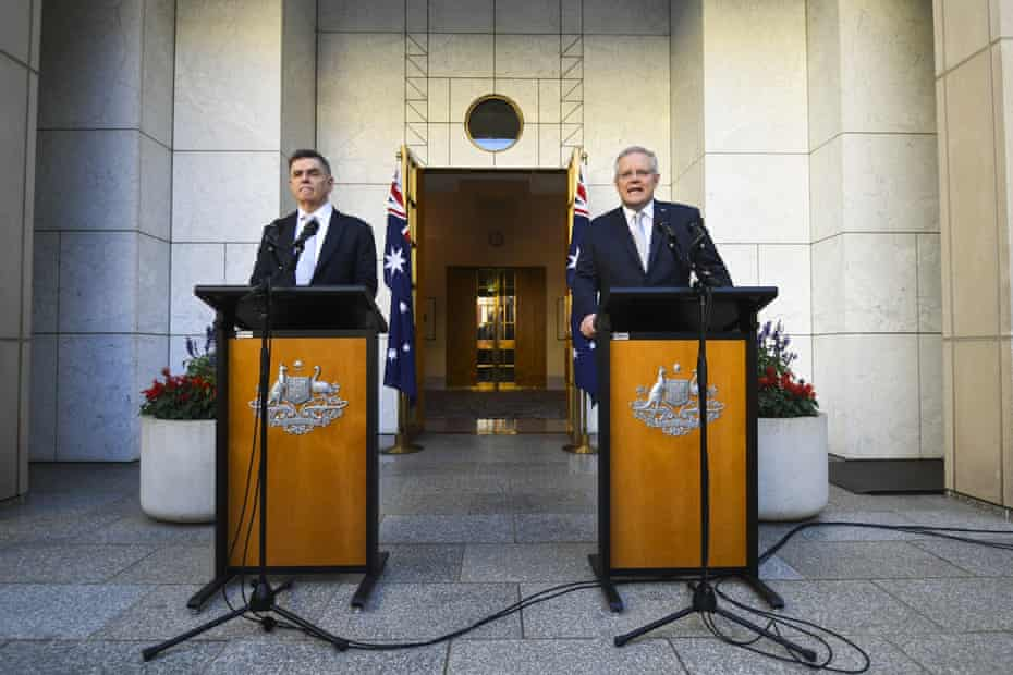 Australian Prime Minister Scott Morrison (right) and Australia's Chief Medical Officer Brendan Murphy speak to the media during a press conference at Parliament House in Canberra, Wednesday, March 18, 2020.