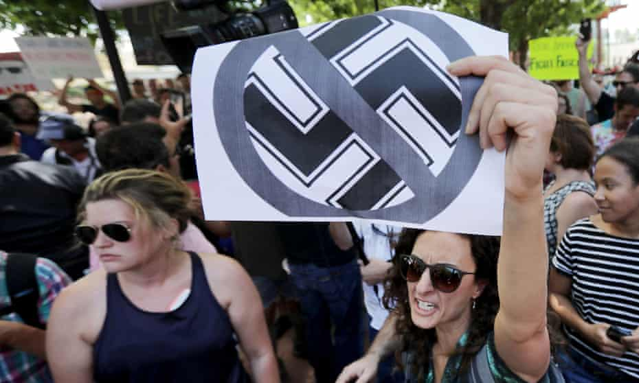 Protesters shout anti-Nazi chants after chasing alt-right blogger Jason Kessler from a news conference on 13 August 2017 in Charlottesville, Virginia.