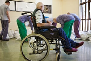 A man in a wheelchair during laundry collections at HMP Littlehey in Cambridgeshire.