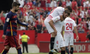 Sevilla's Grzegorz Krychowiak, right, and Coke, celebrate at the end of the match.