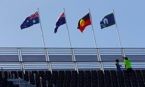 A Torres Strait Islands flag,  an Australian Aboriginal flag, the Queensland  flag and the Australian national flag