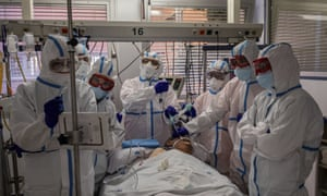 A patient infected with Covid-19 is treated at a hospital in Leganes, on the outskirts of Madrid.