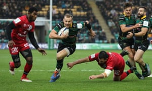 Rory Hutchinson breaks clear to score the opening try for Northampton.