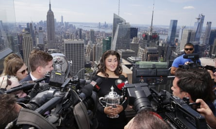 US Open women's champion Bianca Andreescu with her trophy at the top of Rockefeller Center in New York.