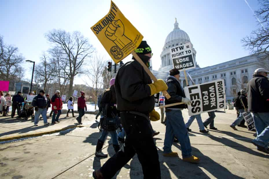 Thousands of union works rally in Wisconsin against a 2015 effort to outlaw mandatory dues.