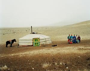 A family outside their ger (yurt) near Üüreg Lake