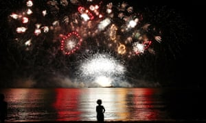 A young girl watches a fireworks display