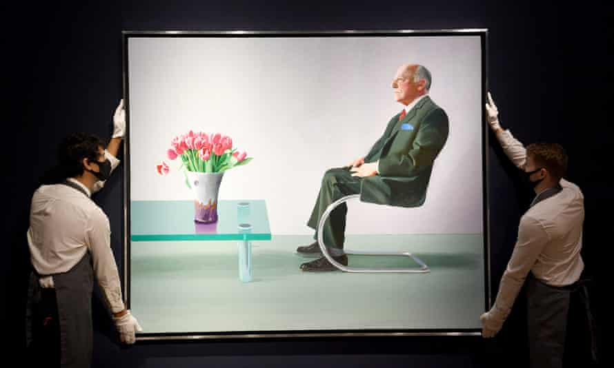 Staff at Christie's adjust David Hockney's 'Portrait of Sir David Webster', which was sold by London's Royal Opera House.