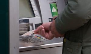 A person using a cash machine
