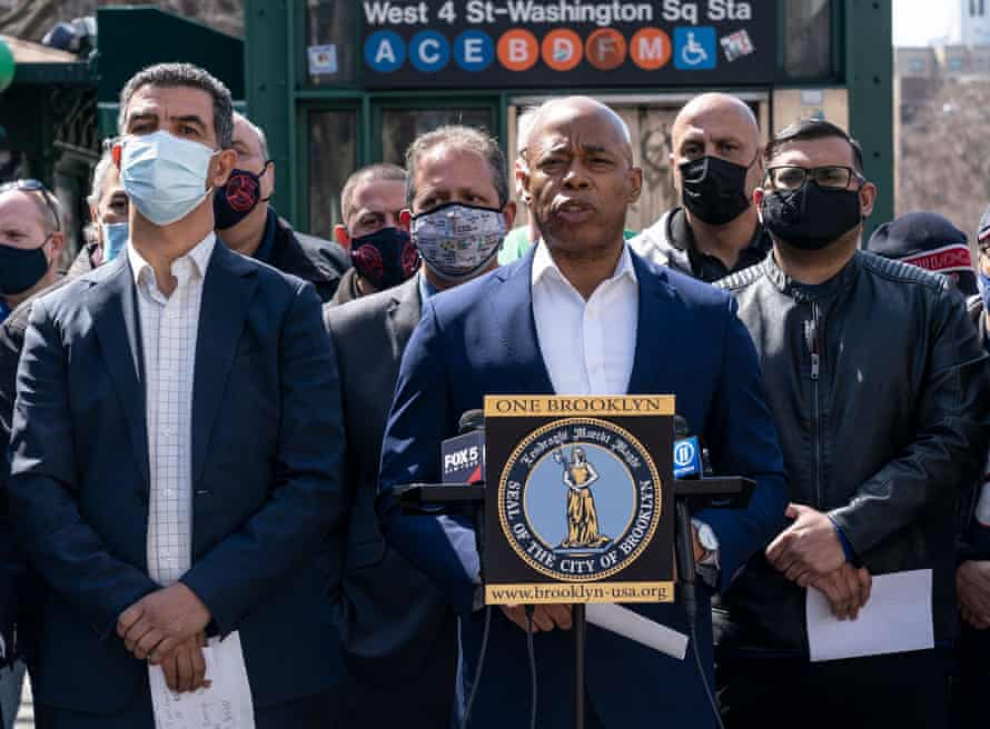 Mayoral candidate Eric Adams, center, accused Yang of abandoning New York City at 'its darkest moment'.