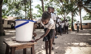 Children at a Unicef hand-washing point installed to help contain the latest Ebola outbreak.