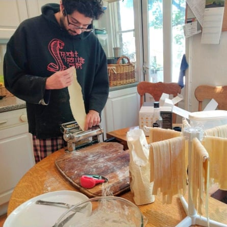 Zain Odho, an NHS clinical scientist, perfects pasta-making at home in London.