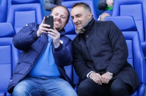 Sheffield Wednesday manager Carlos Carvalhal shares a selfie with a fan.