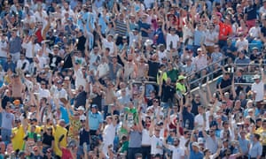 The fans on the Western Terrace sing a song about Ben Stokes while holding their shoes up after watching their heroes during day four of the third Test at Headingley.