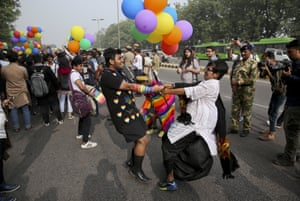 Two participants hold hands and dance as gay rights activists and their supporters march during a gay pride parade in New Delhi