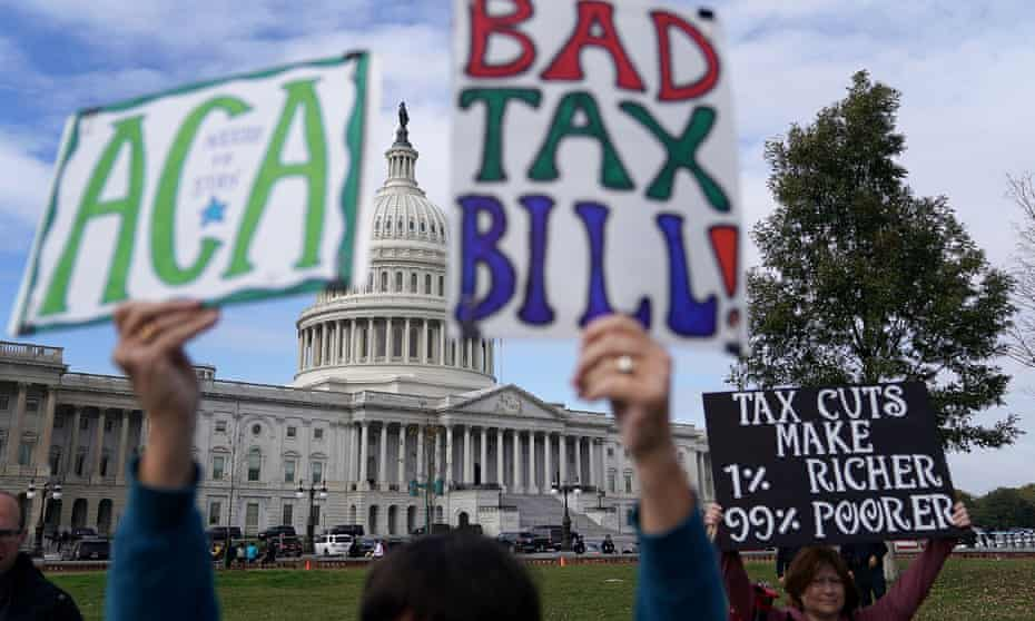 Demonstrators join a rally against the proposed Republican tax reform legislation in Washington Wednesday.