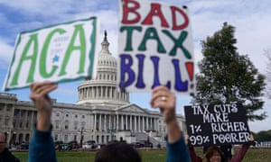 Demonstrators join a rally against proposed Republican tax reform legislation in Washington DC on 17 November 2019.