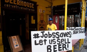 Sign outside beerhouse saying 'Jobs saves lives let us sell beer'