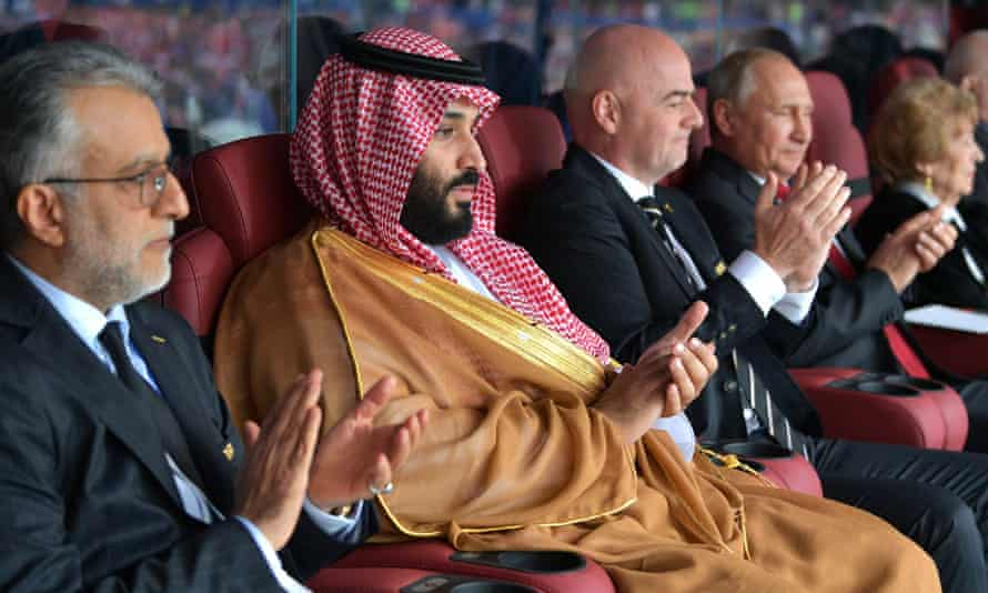 Mohammed bin Salman with the heads of the Asian Football Confederation and Fifa, and Vladimir Putin, at the 2018 World Cup in Russia.