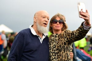 The 83-year-old farmer and festival organiser, Michael Eavis, welcomed the crowds as the gates opened while posing for selfies with fans
